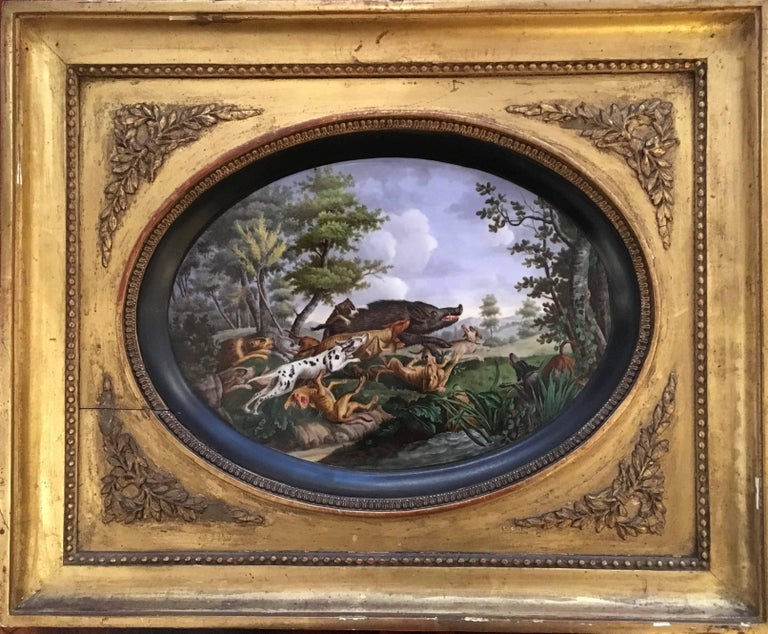 Pair of framed hand-painted Paris porcelain hunting scenes,