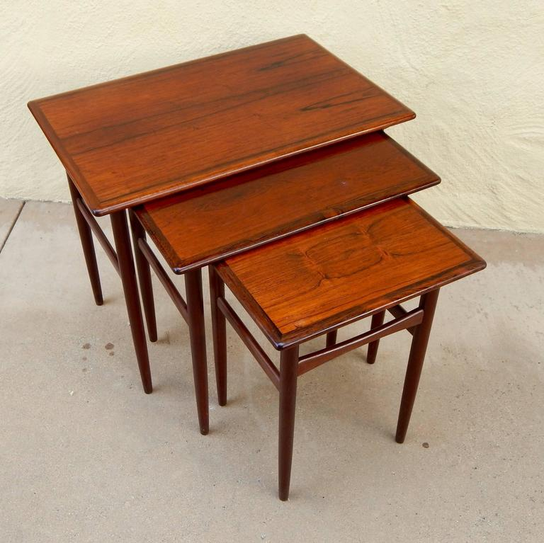 Set of Three Swedish Mid-Century Modern Rosewood Nesting Tables, circa 1950 In Excellent Condition For Sale In Los Angeles, CA