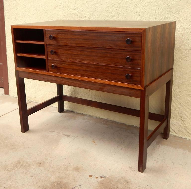 Danish Mid-Century Modern storage chest rendered in highly figured rosewood. See detail photos for drawers and interior storage. In excellent original condition.