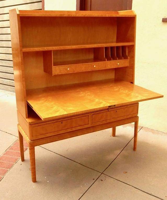 Swedish Art Moderne dry bar- desk in golden flame birch, circa 1940. Rendered in highly figured, bookmatched birch. Interior composed of birch and Karelian birch. See photos for details.
