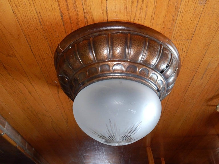 Swedish Arts & Crafts era flush mount lighting fixture in hand-hammered copper. With original all etched/sandblasted glass shade. Three bulb receptacles with standard bases. Price includes complete rewiring.