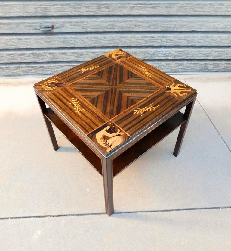 Intricately inlaid Swedish Art Deco era side table. Inlaid with zodiac theme. Present in inlaid friezes are pieces, Gemini and others! Rendered in Book matched walnut and birch wood. With inlay in rosewood, ebony, birch root and pear. Made at Mjölby
