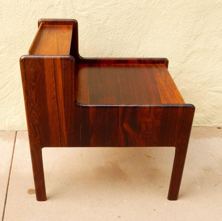 Danish Mid-Century Modern end table in rosewood with birch wood interior. Finger jointed drawers. Inset metal drawer pull, Denmark, circa 1960. Contact us with any questions.