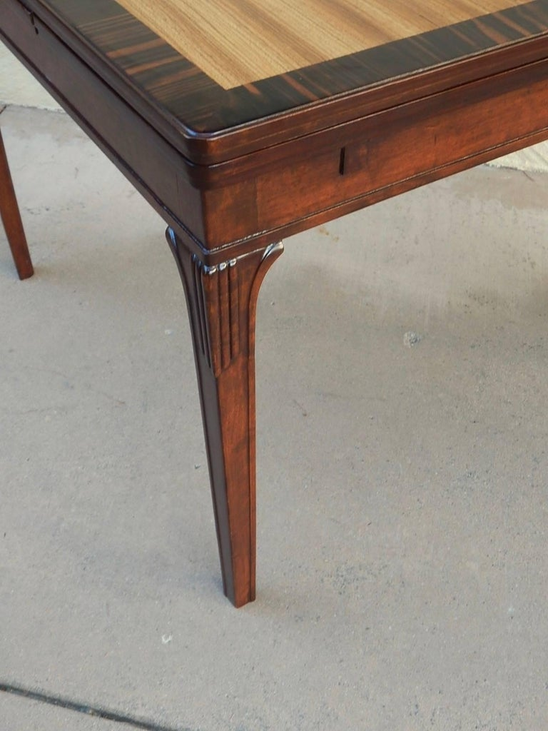 Swedish Art Deco extendible side table by Eric Chambert, circa 1930. Rendered in birch wood and zebrino with parquetry top in elm. There are two concealed leaves which extend the top to a total of 57 inches. This table has just been impeccably
