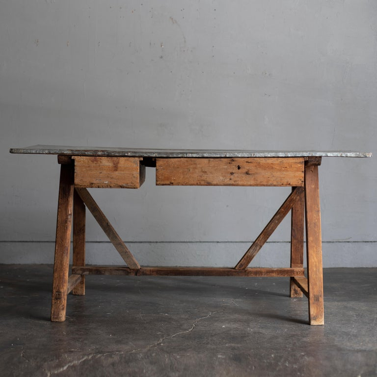 An antique zinc top work table from Italy, 1870s. The top board with exquisite color and texture. The wood part has warm feel. Two large and small drawers. Will attach handles to the drawers.