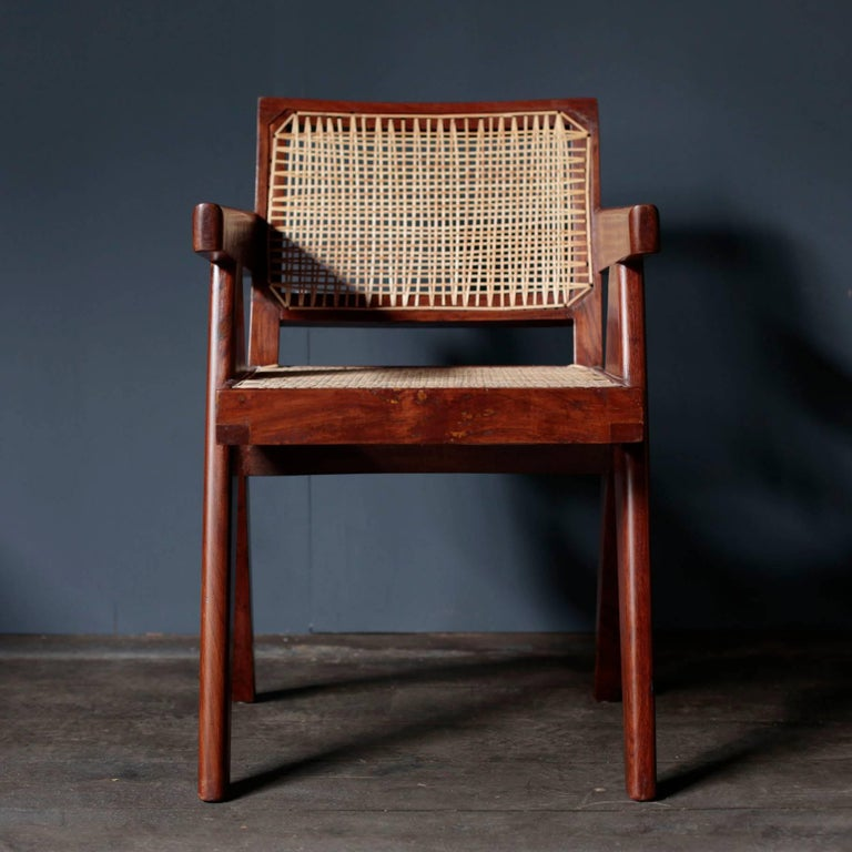 Office cane chair designed in the midcentury by Pierre Jeanneret for various buildings in the city of Chandigarh. This is a model made with rosewood.