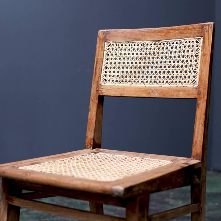 Dining chair designed in the middle century by Pierre Jeanneret for use in Chandigarh's residence.