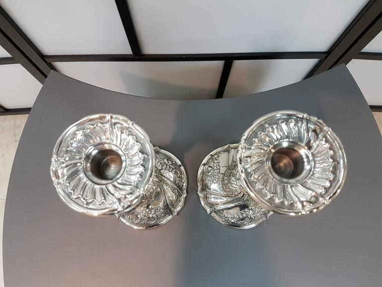 Pair of silver 800 candlesticks in Italian Barocco Genoese style.
