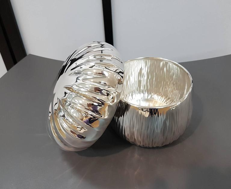 Decorative silver 800 mushroom shape box. The body is embossed and cheased completely by hand. 385 grams.