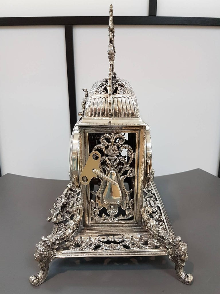 Solid silver 800 silver neo-Gothic silver table clock. The clock was made in casting and chiselling.