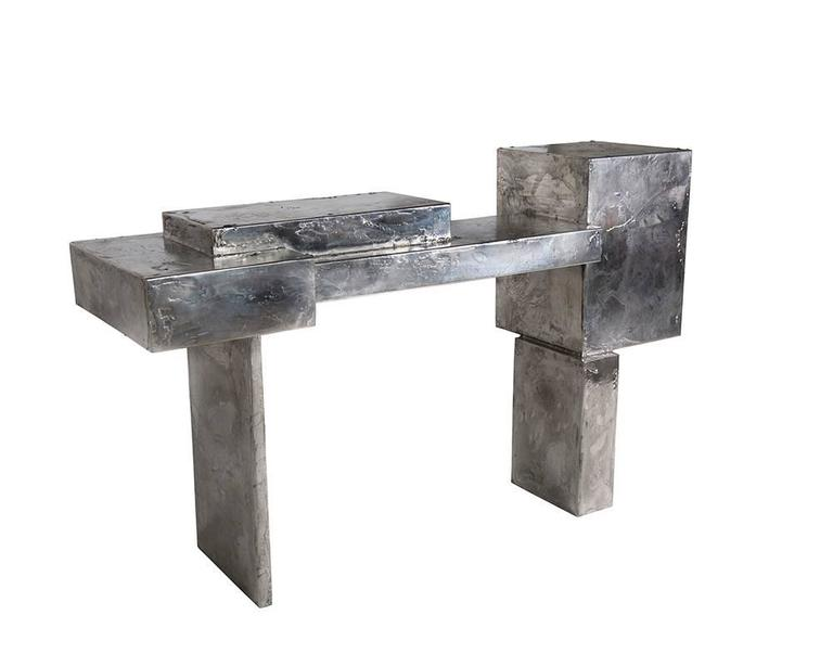 The Pewter collection is a family of furniture pieces defined by their materiality and formal qualities. One Crucible at a time, pewter is melted into liquid form and hand coated onto the steel structure, creating the other-worldly surface that