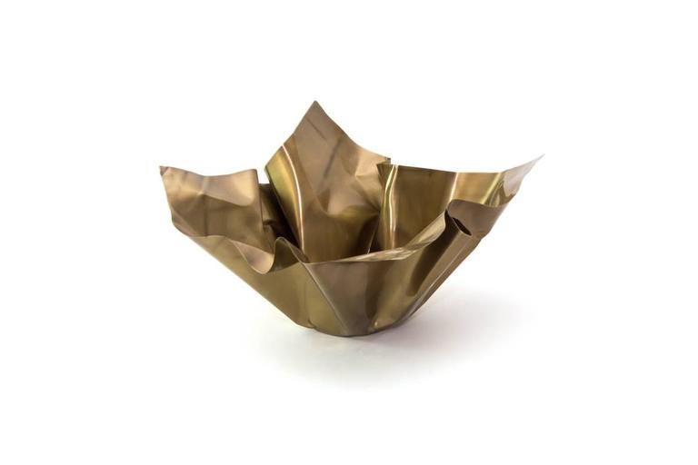 The Paper Series embodies the idea of crumpling paper set in time. The materiality of the brass is utilized by the intricate folds and bends that not only resemble paper, but adds structure to the bowl. Each Paper is unique and hand-sculpted in