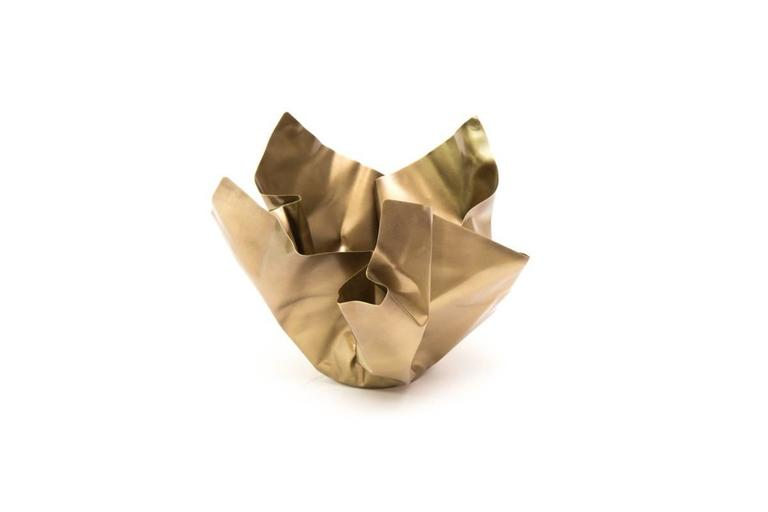 The Paper Series embodies theIdea of crumpling paper set in time. The materiality of the brass is utilized by the intricate folds and bends that not only resemble paper, but adds structure to the bowl. Each Paper is unique and hand sculpted in