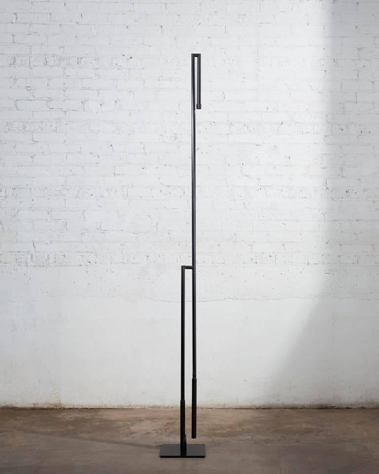 Floor lamp in darkened brass with LED. Custom finishes available.