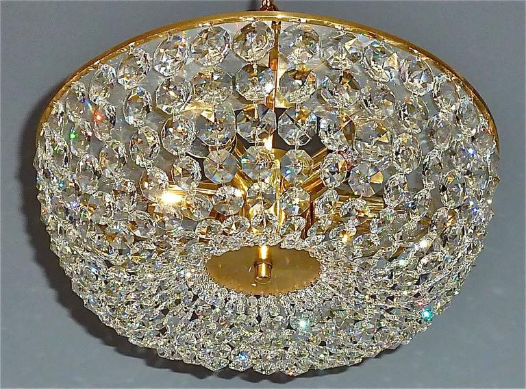 Beautiful Mid-Century sparkling diamond-shaped cut crystal glass and patinated brass chandelier by Bakalowits & Söhne, Vienna, circa 1960s. This piece, stamped No. 22, is of high quality and made with best materials. The wiring is perfect, so it is