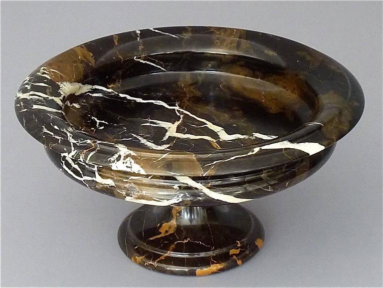 Beautiful antique neoclassical centerpiece or tazza which is a bowl mounted on a pedestal with veining in black, white and brown marble, Italy 19th century, circa 1880-1900. It is 19 cm / 7.48 inches tall and has a width of 36 cm / 14.17 inches. The