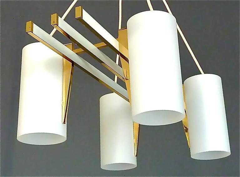 Sculptural four-light chandelier in the style of Angelo Lelli for Arredoluce. It is made of a white enameled metal, brass metal construction with highly sophisticated brass details and four satin frosted glass tube shades. The awesome pendant lamp