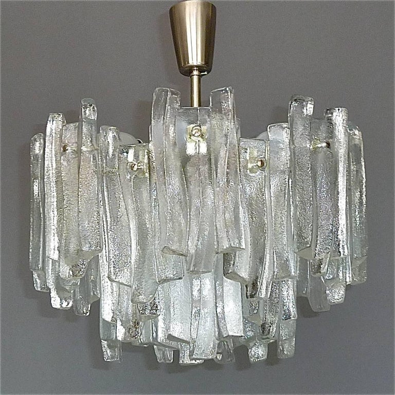 Rare signed and beautiful Kalmar Franken KG nickel-plated brass multi-tiered Sputnik construction flush mount with 28 wavy frosted textured ice glass panels, executed in the 1960s in Germany. The modernist flush mount or chandelier takes nine E14