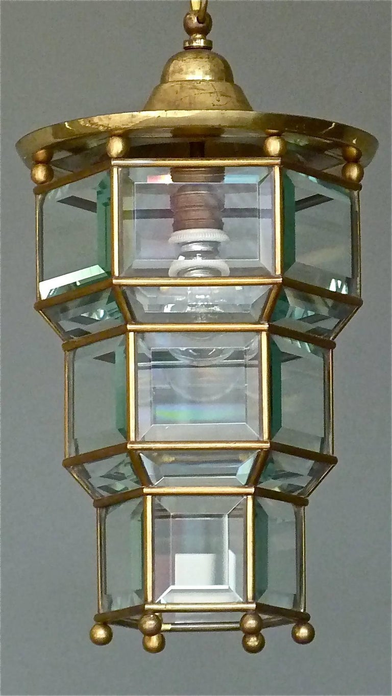 Amazing Adolf Loos / Josef Hoffmann Style Vienna Secession Pendant, Austria, circa 1905-1910. Antique patinated brass metal light corpus with hand-cut beveled crystal glass sections, possibly from Lobmeyr. It has one porcelain / brass fitting for