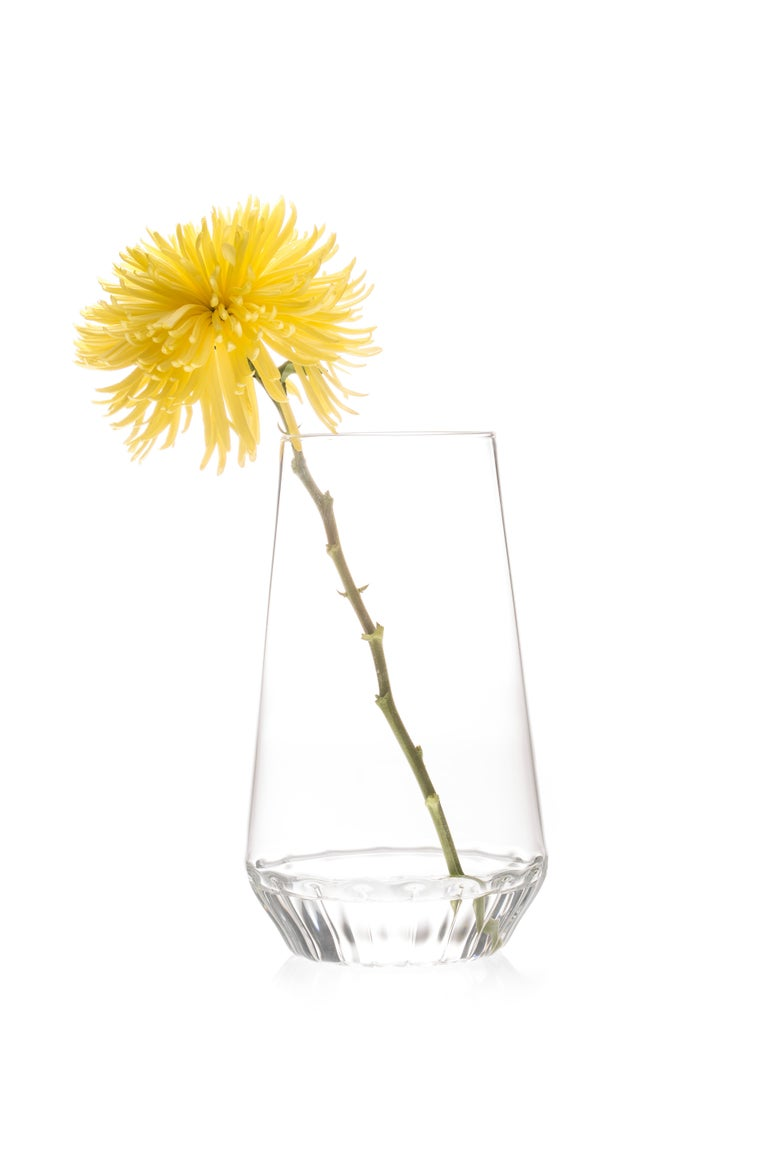 The Contemporary Czech clear glass Rossi large vase, from a single stem to a beautiful bouquet, the modern and minimal Rossi vases highlight any flower arrangement they contain by masking the stems at the bottom of the vase. For everyday use or