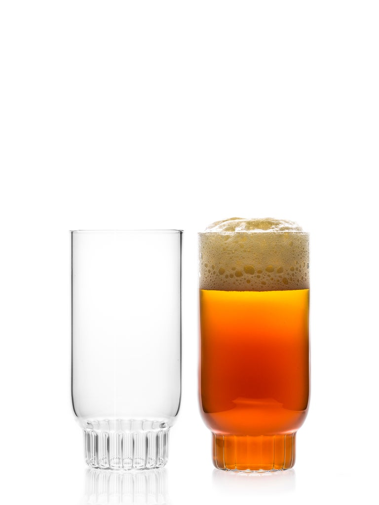 Rasori large highball glasses - set of two.  As the designer's favorite street in Milan, her home away from home, the clear Czech contemporary Rasori Large glasses are a playful and delicate combination of materials and form, just like the city