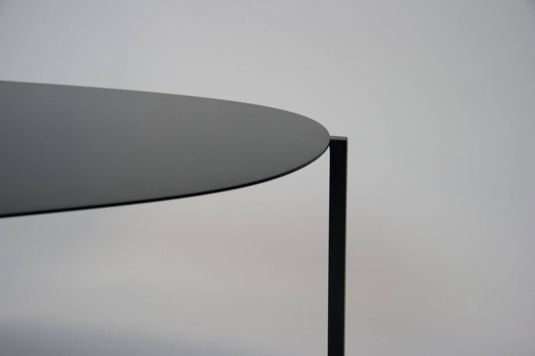 The organic, minimal yet modern sculptural hand-painted coffee table, the Ishicoro 2 was inspired by the Japanese word for 'river rock'. The contemporary, hand-painted, steel coffee table is ever dynamic depending on how it is viewed and works well