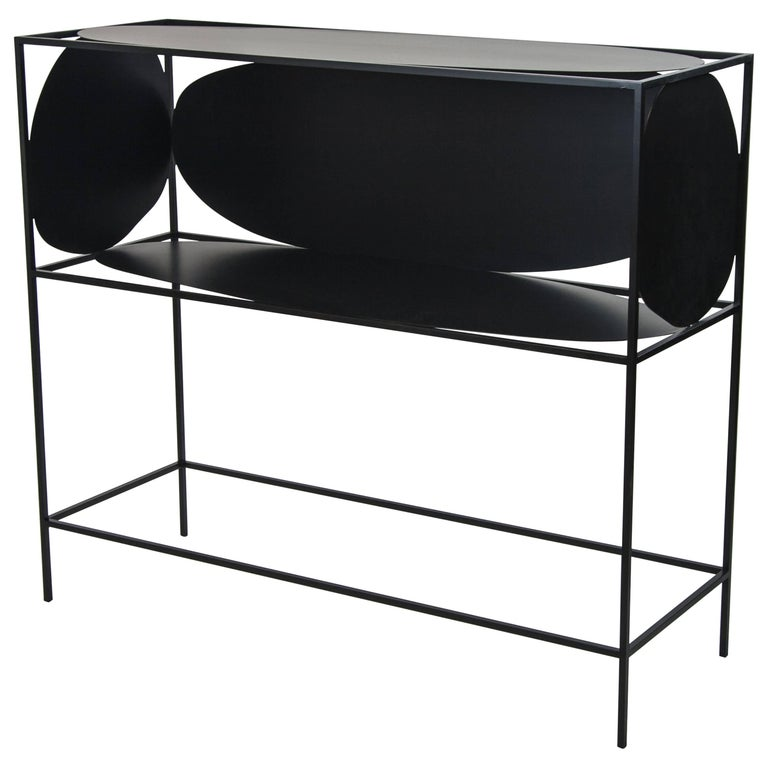 A study in positive and negative space, the modern contemporary black steel metal Ahn credenza bar or buffet is ever changing depending on how it is positioned and viewed in a room. With its five different asymmetrical and organic surfaces, Ahn is a
