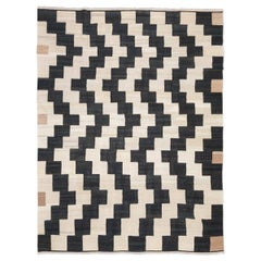 Contemporary Kilim in Black, Beige and Earth tones.
