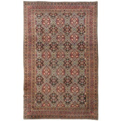 20th Century with Blue and Green Flowers over Wool Kirman Rug