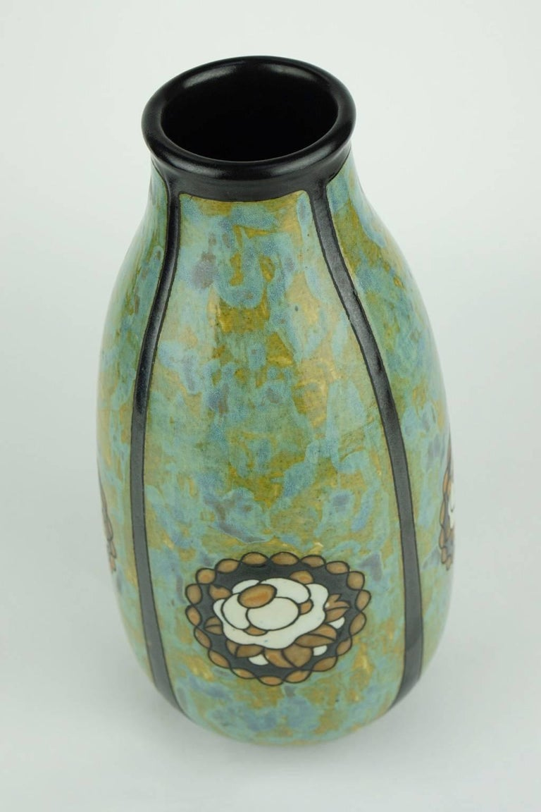 Matte stoneware Art Deco vase signed Ch. Catteau. Design 771. The design is made of floral medallions on marbled background each in one of four quartets. (Form 396).  Size: H 27 cm, diameter base 9 cm, diameter top 6 cm.