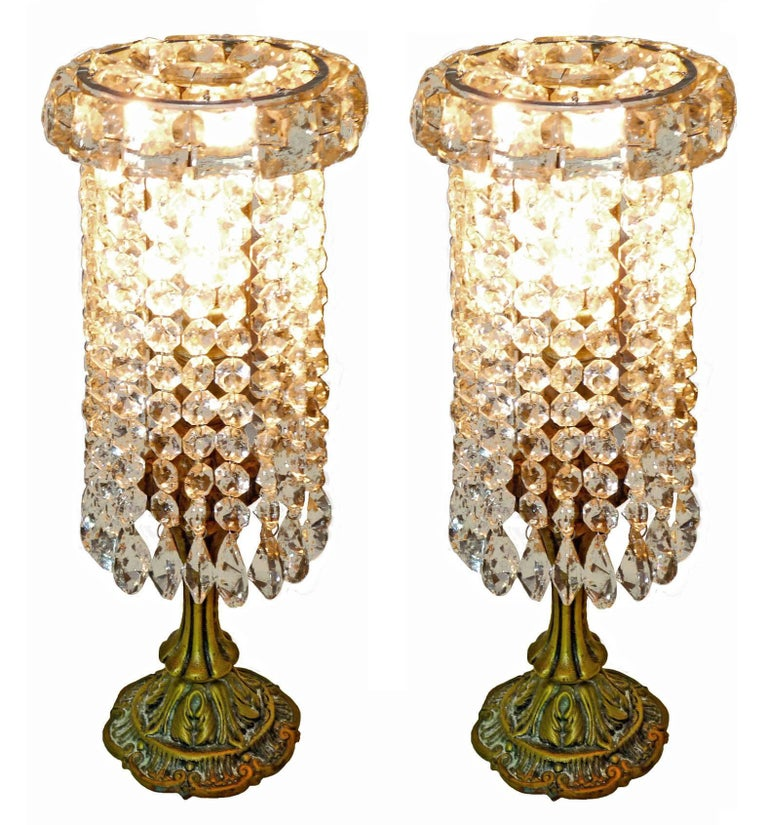 Pair of French Regency Empire in bronze and crystal table lamps Housing one-light bulb each E14. Bronze detailing with all crystal intact. Measures: Height: 13 in /33 cm Diameter: 6 in /15 cm Weight: 8 lb. / 4 kg Two light bulbs ( E14 ) Good
