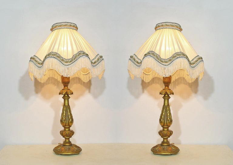 20th Century Pair of Italian Baroque Carved Giltwood Candlesticks Torchères Ivory Table Lamps For Sale