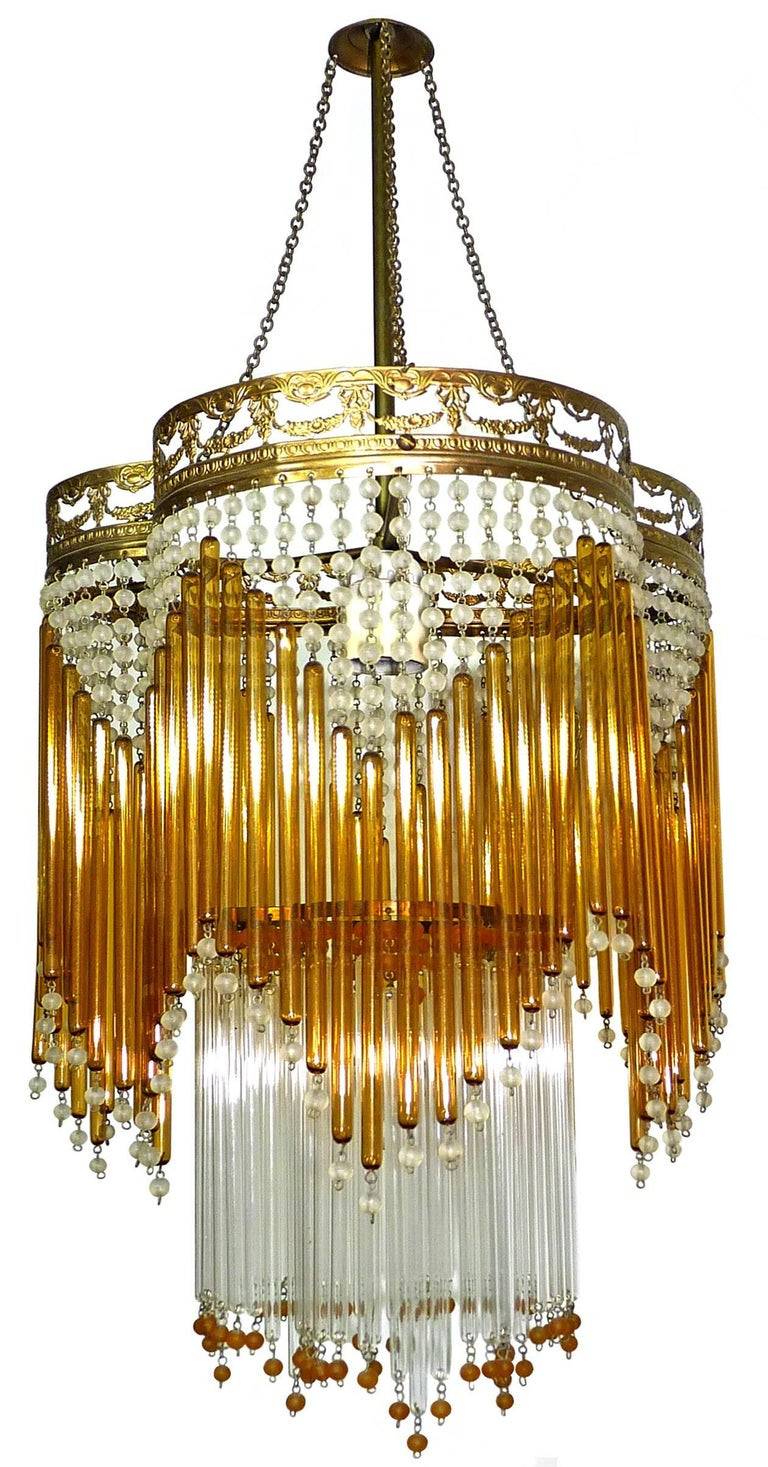 Beautiful Italian Mid-Century in clear and amber Murano beaded glass Art Deco / Art Nouveau chandelier Measures:  Diameter 30 cm Height 87 cm One light bulb E27/ good working condition/European wiring. Age patina Also have matching chandeliers