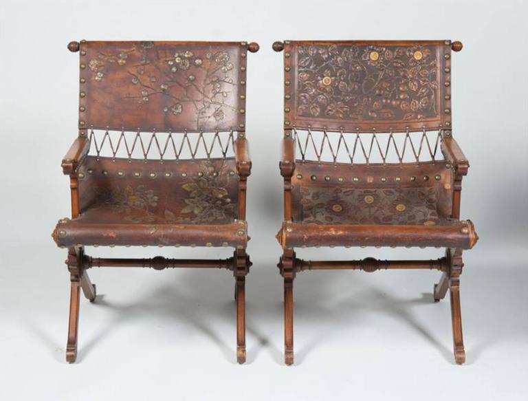 A fine and rare pair of aesthetic movement carved walnut and embossed and gilt-leather armchairs Attributed to George Hunzinger, 1835-1898, circa 1870s  Measures: Height 33 in. width 24 in. depth 28 1/2 in.  A fine & rare aesthetic armchairs