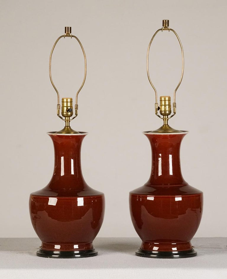 """A pair of """"Sang de Boeuf"""" lamps Early 20th century  A pair of """"Sang de Boeuf"""" vases now mounted as lamps.  Measure: Height 29 in.   Provenance:  Private collection, Ma.   Lamp32."""