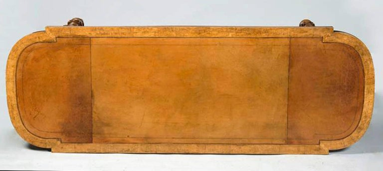 A fine early Victorian carved maple and tiger maple  Library table/writing table,  19th century  Fitted with a leather writing surface.  Measures: Height 30 in., Width 82 ½ in., Depth 30 in.  Provenance: Property from a Private