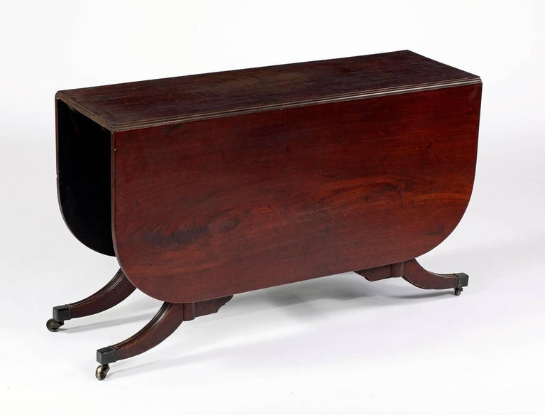 """A rare mahogany Cumberland action Diningtable Possibly Duncan Phyfe workshop 18th century Measures: Height 28 ½ in. Width 47 ½ in. Depth 15 ½ """"Closed"""" Depth 47 ½ in. by 58 in.  Provenance: Private Collection New York Le Trianon Fine Art"""
