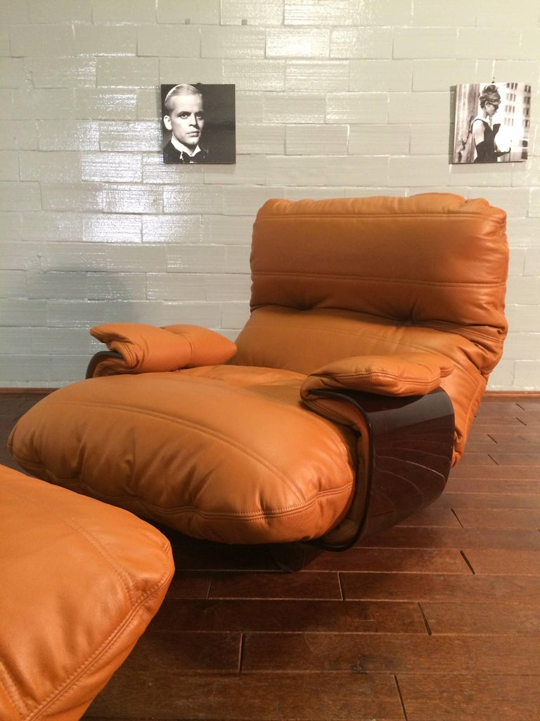 This Marsala lounge chair and pouf were designed by Michel Ducaroy in the 1960s and were manufactured by Ligne Roset in France during the 1970s. They have been reupholstered in genuine cognac leather and each feature the original Ligne Roset logo.