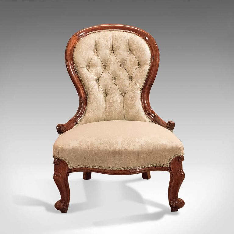 This is a Classic Victorian, antique salon chair dating to the early 19th century, circa 1840.