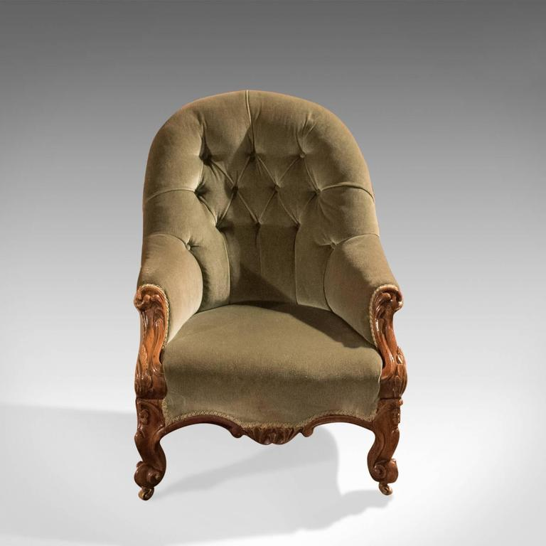 This is an early Victorian, button-back, antique salon chair offering a comfortable seat and dating to circa 1840.
