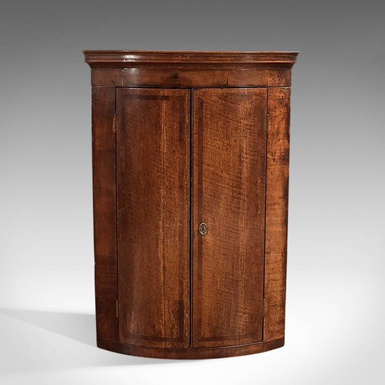 This is an antique, Georgian, bow fronted, hanging corner cabinet dating to, - 18th Century Antique Corner Cabinet, Georgian Hanging Cupboard