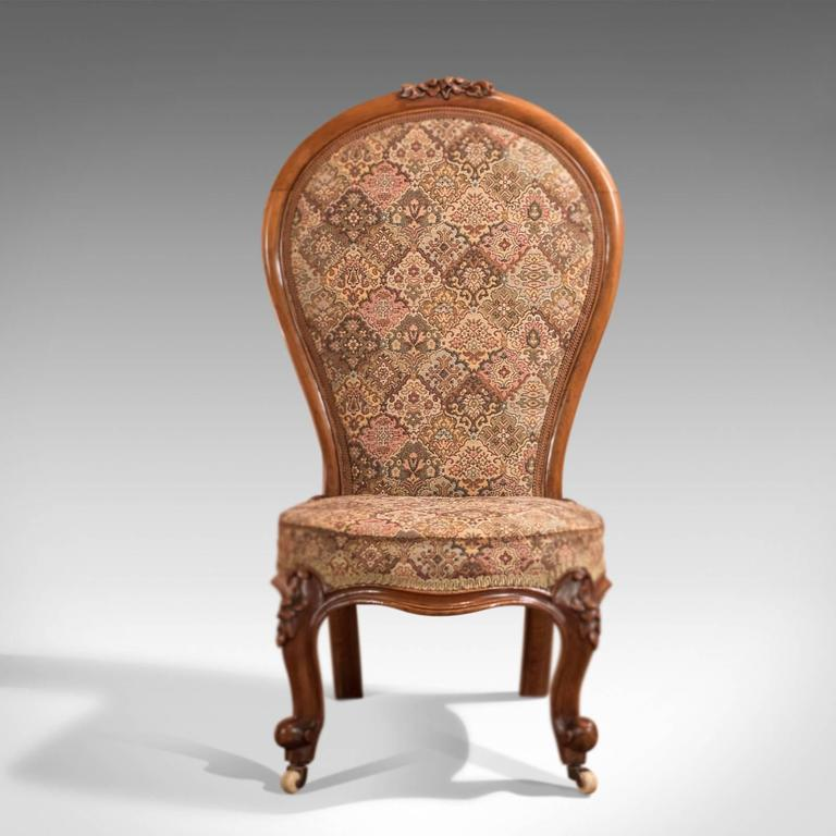This is a Regency, antique nursing chair dating to circa 1820. The quality  walnut - 19th Century Antique Nursing Chair, English Regency, Circa 1820 For