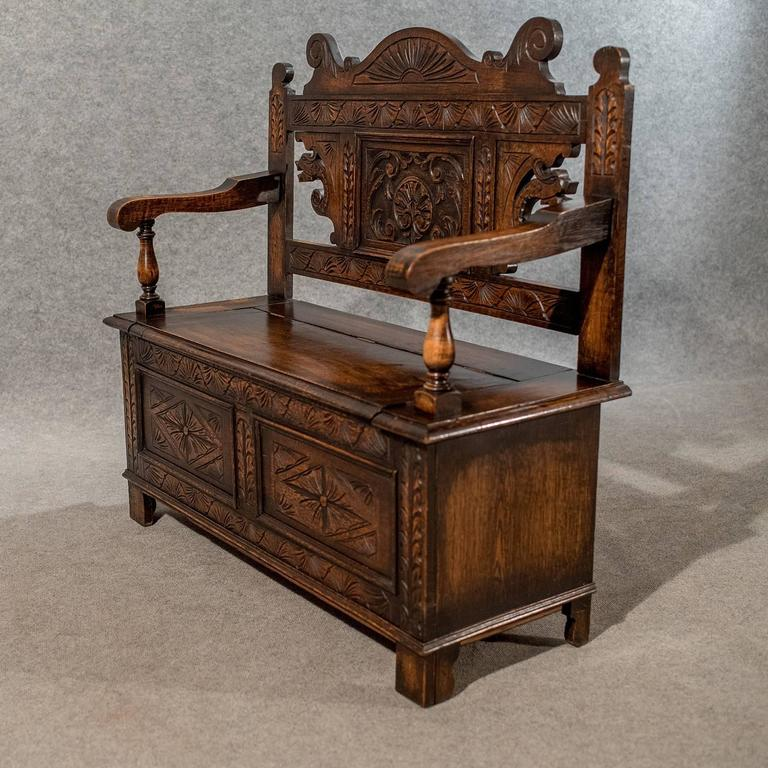 Carved oak settle bench pew hall seat with locker english