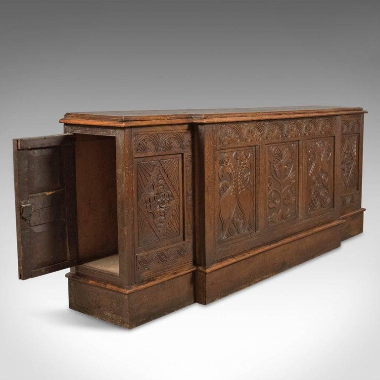 Antique long cupboard english carved oak dresser base for Carved kitchen cabinets