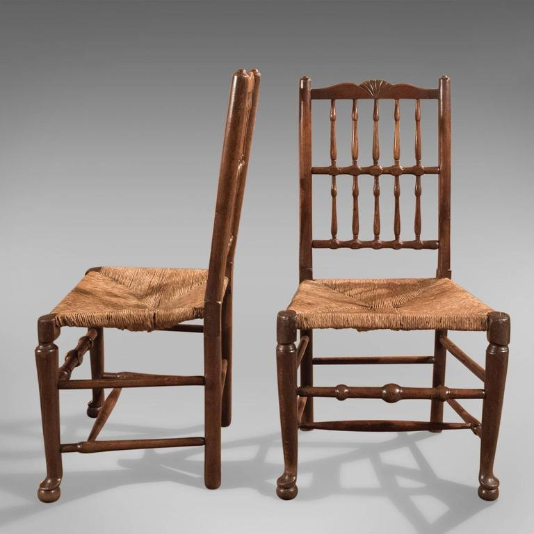 Country Harlequin Set of Seven Antique Spindle Back Dining Chairs, circa 1800 For Sale
