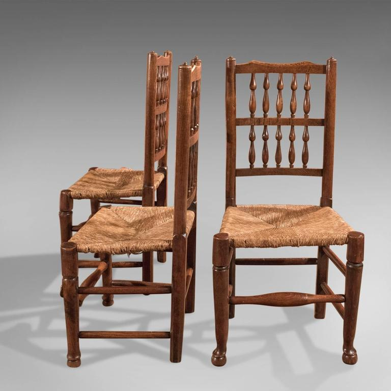 British Harlequin Set of Seven Antique Spindle Back Dining Chairs, circa 1800 For Sale