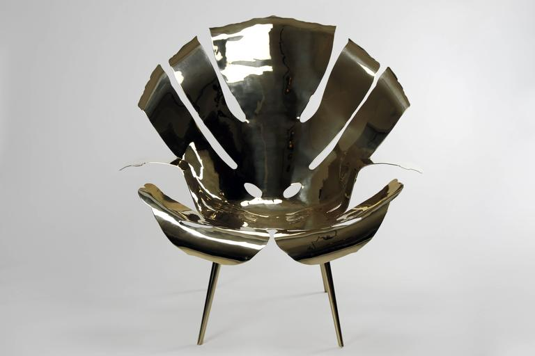 The Philodendron Leaf Lounge Chair is one-of-a-kind, edition of 8 and is a  beautifully crafted hand-forged brass sculpture.  The Philodendron leaf shape lent itself perfectly to making a very comfortable lounge chair that went through many design