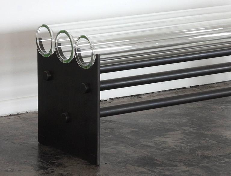 The Museum Bench was originally envisioned to be placed near art, as to not obstruct the view.  This heavy industrial minimal modern piece is definitely a conversation starter.  It's made of commercial grade glass pipes strong enough to hold up to