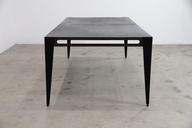 The ICON Table works as a desk, conference table, or dining table and pairs with the ICON Chair in rope or leather sling. (see separate listing) It is built of solid steel with a bronzed patina and the legs are upholstered in hand stained lamb