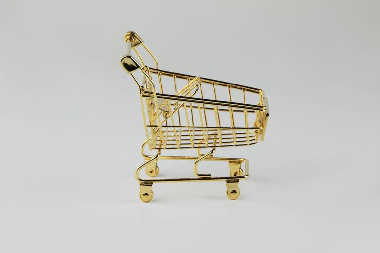The 'Gold Cart' is a FULLY articulated solid 14K gold working shopping cart. The 14K gold wire is bent and sculpted and joined together by solid gold casted parts. This is an addition of 12 + artist proof.  'Gold Cart' is really fun activated in a
